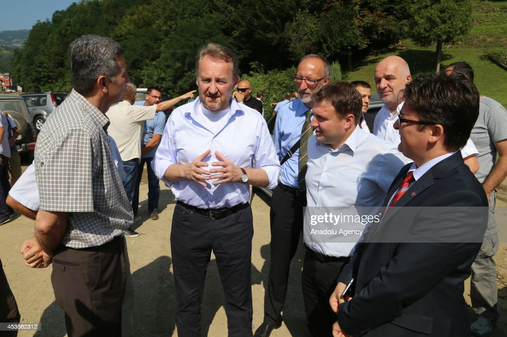 Bosniak member of the three-membered presidency council of Bosnia and Herzegovina, Bakir Izzetbegovic speaks with victims of flood disaster, occured on May, in Jelyezno Polye, Bosnia and Herzegovina on 13 August, 2014.
