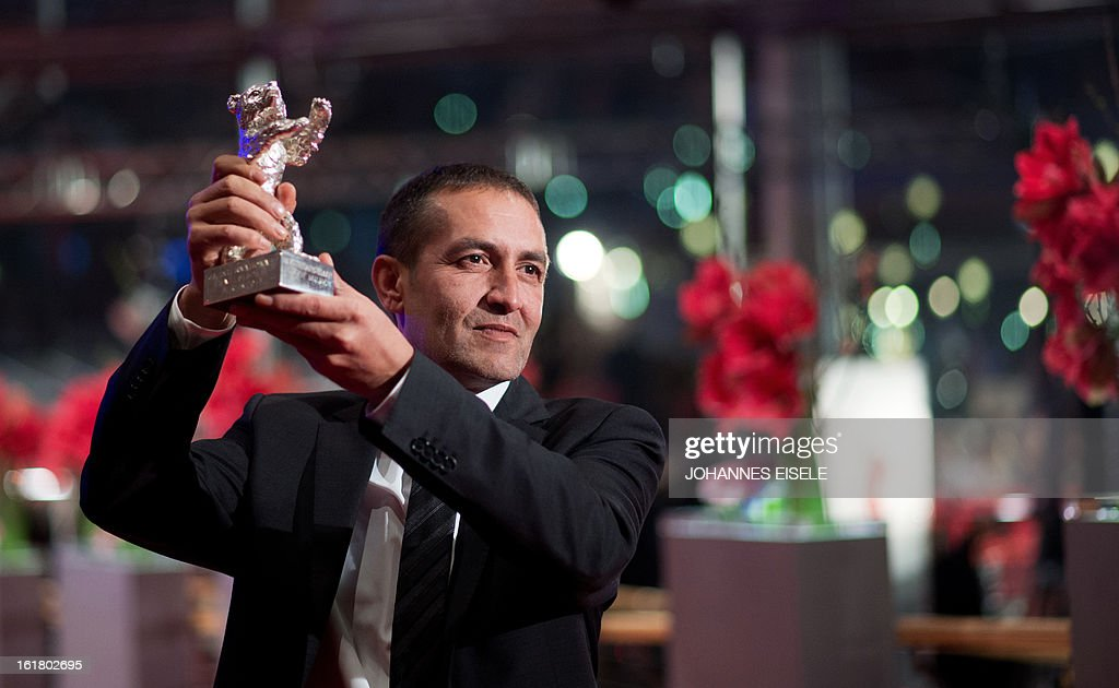 Bosnian actor Nazif Mujic holds the Silver Bear for Best Actor he received for the film 'Epizoda u zivotu beraca zeljeza' (An episode in the life of an iron picker) as he poses after the awards ceremony of the 63rd Berlinale Film Festival, in Berlin on February 16, 2013.