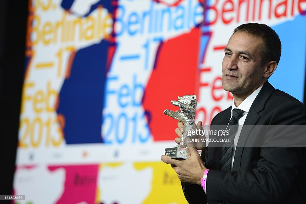 Bosnian actor Nazif Mujic holds the Silver Bear for Best Actor he received for the film 'Epizoda u zivotu beraca zeljeza' (An episode in the life of an iron picker) during a press conference following the 63rd Berlinale awards ceremony in Berlin on February 16, 2013.