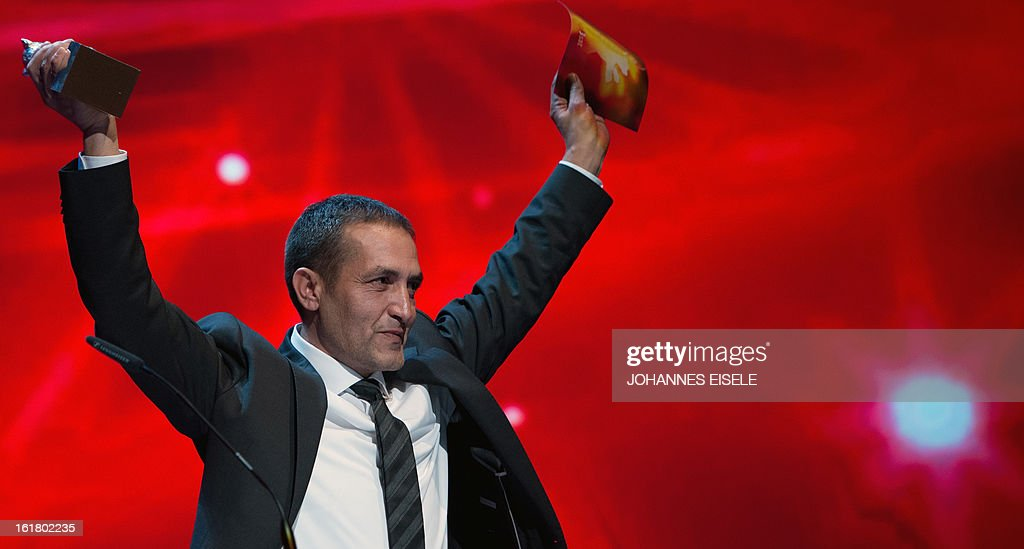 Bosnian actor Nazif Mujic receives the Silver Bear for Best Actor for the film 'Epizoda u zivotu beraca zeljeza' (An episode in the life of an iron picker) during the awards ceremony of the 63rd Berlinale Film Festival, in Berlin on February 16, 2013.