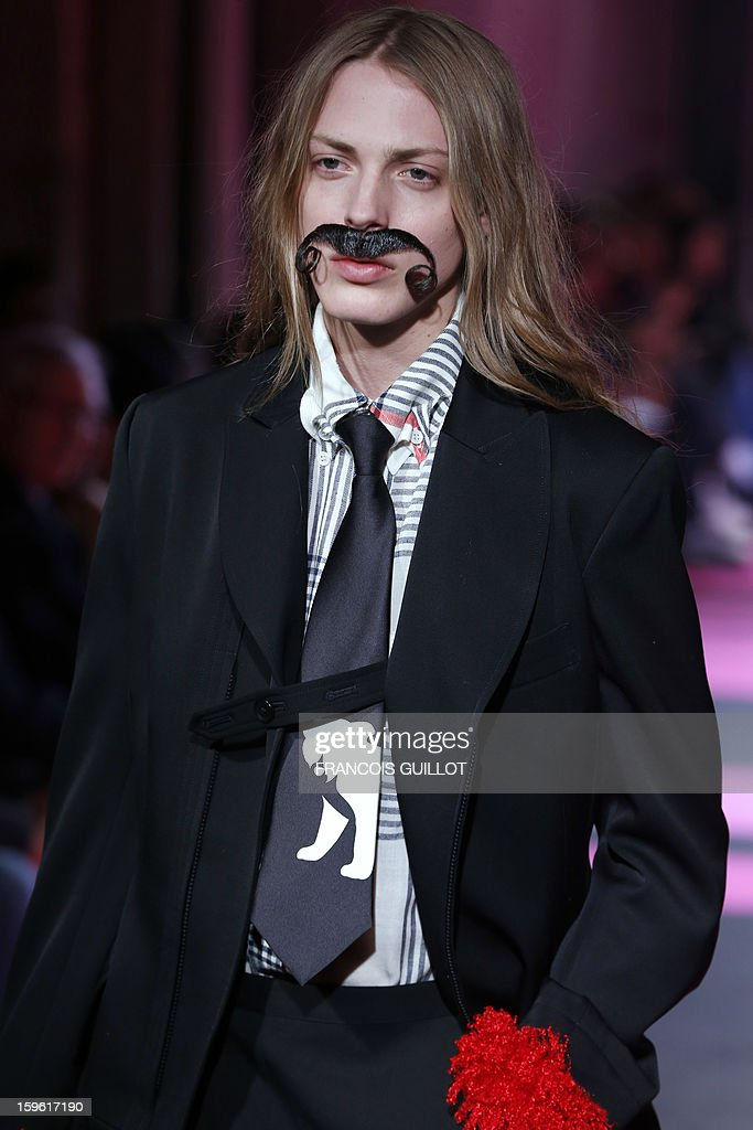 Bosnian Australian Model Andrej Pejic presents a creation by designer Yohji Yamamoto during the men's Fall-Winter 2013-2014 collection show on January 17, 2013 as part of the Men's fashion week in Paris.
