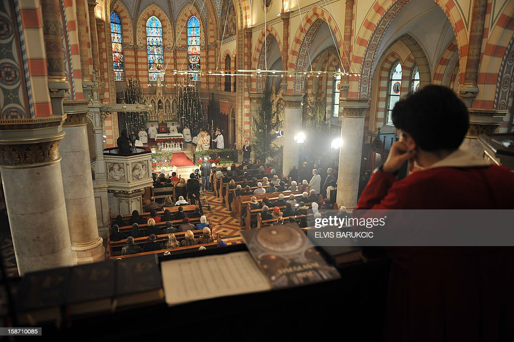 A Bosnian Croat woman attends the Christmas Mass at the Cathedral of The Heart Of Jesus, early on December 25, 2012 in Sarajevo.