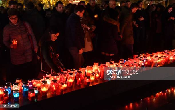 TOPSHOT Bosnian Croats and residents of Mostar light candles in in tribute to General Slobodan Praljak on November 29 after Bosnian Croat war...