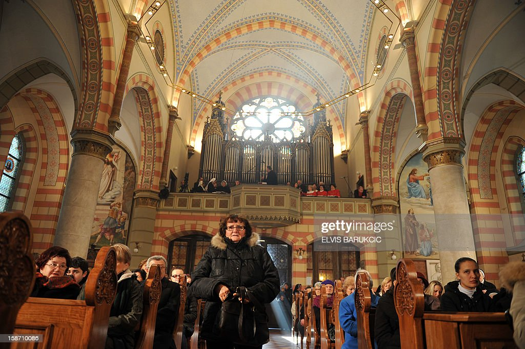 Bosnian Croats attend the Christmas Mass at the Cathedral of The Heart Of Jesus, early on December 25, 2012 in Sarajevo.