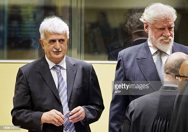 Bosnian Croats Bruno Stojic and Slobodan Praljak stand in the courtroom May 29 2013 before their sentencing at the International Criminal Tribunal...