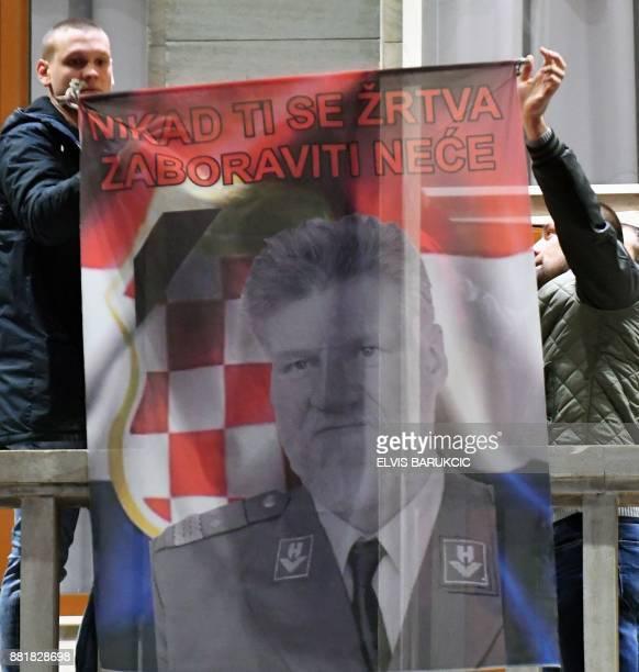 Bosnian Croats from Mostar raise a Croat flag featuring a portrait of General Slobodan Praljak in Mostar on November 29 after Bosnian Croat war...