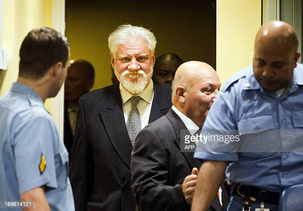 Bosnian Croats Milivoj Petkovic and Slobodan Praljak enter the courtroom May 29 2013 before their sentencing at the International Criminal Tribunal...