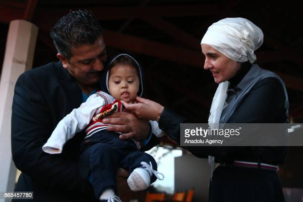 Bosnian Director Aida Begic takes care with a baby with down syndrome after the screening of his movie 'Never Leave Me' during a gathering organized...