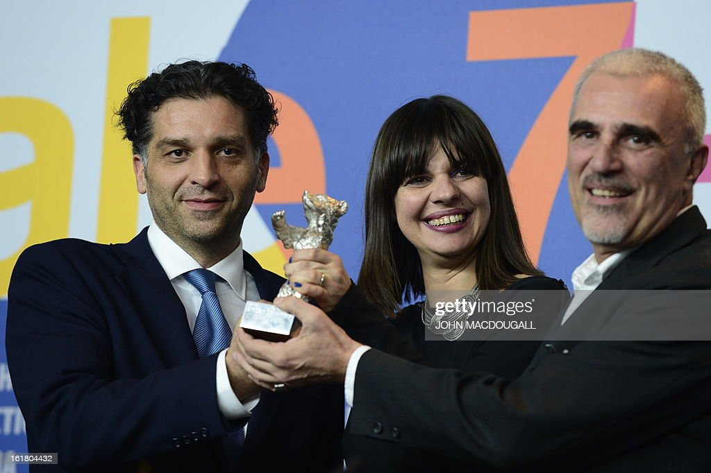 Bosnian director Danis Tanovic (L) and his producers Amra Baksic Camo (C) and Cedomir Kolar pose with the silver bear Jury Grand Prix award for his film 'Epizoda u zivotu beraca zeljeza' (An Episode in the Life of an Iron Picker) ahead of a press conference after the awards ceremony of the 63rd Berlinale Film Festival in Berlin on February 16, 2013.