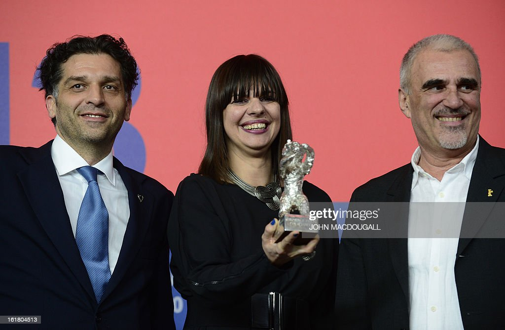 Bosnian director Danis Tanovic (L) and his producers Amra Baksic Camo (C) and Cedomir Kolar pose with the Jury Grand Prix silver bear award for the film 'Epizoda u zivotu beraca zeljeza' (An Episode in the Life of an Iron Picker) ahead of a press conference after the awards ceremony of the 63rd Berlinale Film Festival in Berlin on February 16, 2013. AFP PHOTO / JOHN MACDOUGALL