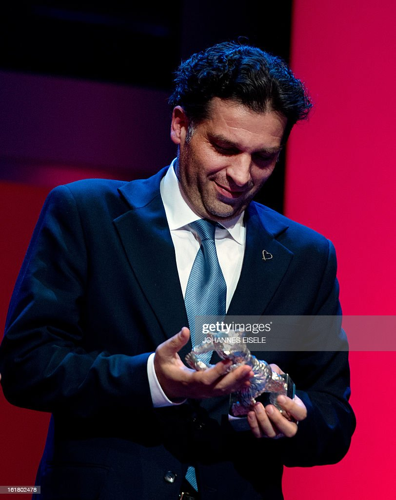Bosnian director Danis Tanovic receives his Jury Grand Prix Silver Bear award for his movie 'Epizoda u zivotu beraca zeljeza' (An Episode in the Life of an Iron Picker) during the awards ceremony of the 63rd Berlinale Film Festival, in Berlin on February 16, 2013.