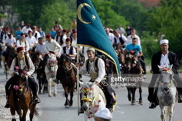 Bosnian horsemen dressed in traditional outfits ride horses during the traditional pilgrimage near central Bosnian town of Prusac on June 24 2012 The...