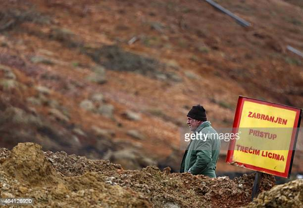 A Bosnian man watches rescue workers following a land slide at a coal mine located close to the Bosnian village of Dubrave near the northeastern town...