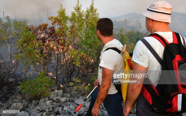 Bosnian men organize themselves to defend their village from oncoming forest fire in the village of Trebizat near SouthernBosnian town of Capljina on...