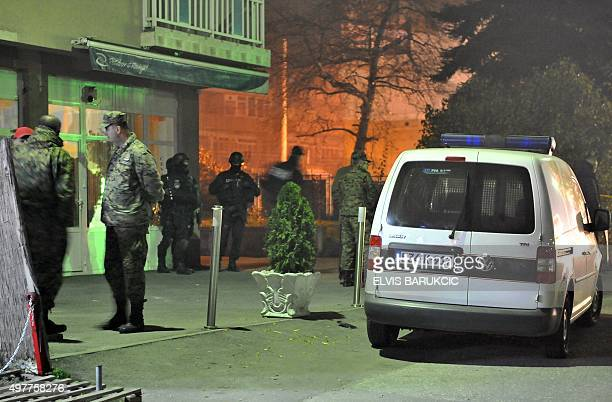Bosnian military personnel are seen working with police during an investigation in Sarajevo's Northern suburb of Rajlovac late on November 18 after...