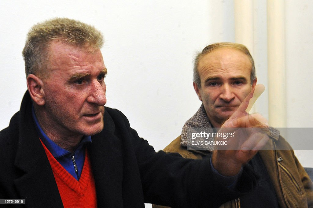 Bosnian Muslim men, Hamdija Vilic (L) and Esad Tufekcic, survivors of the 1992 massacres in the Eastern-Bosnian town of Visegrad, gather on December 4, 2012, to watch in Sarajevo a live television broadcast of the final ruling in the trial of two former Bosnian Serb army officers, Sredoje Lukic and Milan Lukic, before the International Criminal Tribunal for the former Yugoslavia (ICTY) in the Hague. The UN's Yugoslav war crimes court on December 4 upheld murder convictions against two Bosnian Serb cousins but ordered one of their sentences reduced on appeal.The two cousins were appealing their 2009 convictions at the International Criminal Tribunal for the former Yugoslavia (ICTY) for killing Muslims during Bosnia's 1992-95 war in ways the court had described as 'the worst acts of inhumanity'. AFP PHOTO / ELVIS BARUKCIC