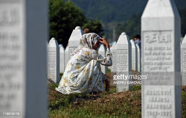 A Bosnian muslim woman mourns at the grave of her relatives at the Potocari Memorial Cemetery near Srebrenica on July 11 2011 This year's mass burial...