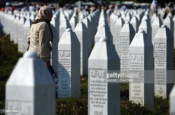 A Bosnian Muslim woman walks past tombstones at the Potocari Memorial Cemetery near Srebrenica on July 11 2011 More than 15000 people gathered Monday...