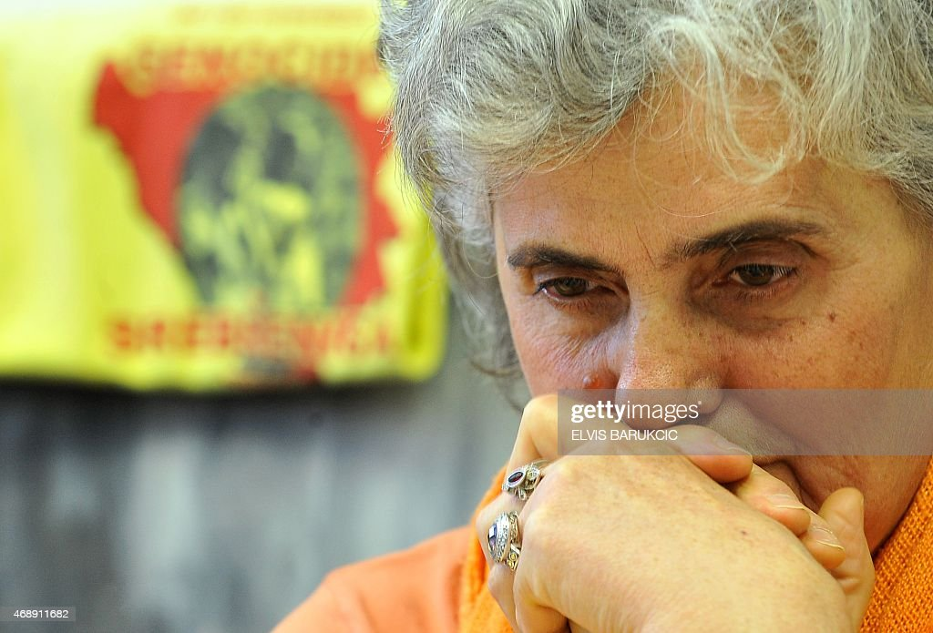 Bosnian Muslim woman, Zumreta Sehomerovic, survivor of the 1995 Srebrenica massacre, watches on April 8, 2015 in Sarajevo a live broadcast from the Yugoslav war crimes court in The Hague, which upheld Bosnian Serb general <a gi-track='captionPersonalityLinkClicked' href=/galleries/search?phrase=Zdravko+Tolimir&family=editorial&specificpeople=4311362 ng-click='$event.stopPropagation()'>Zdravko Tolimir</a>'s life sentence for genocide at the massacre, the worst atrocity on European soil since World War II. AFP PHOTO / ELVIS BARUKCIC