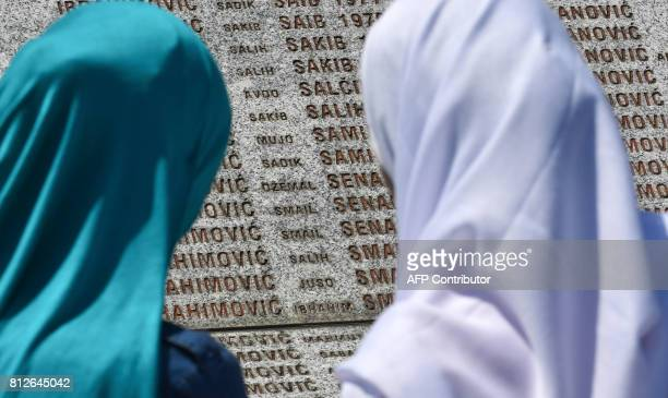 TOPSHOT Bosnian Muslim women survivors of Srebrenica 1995 massacre look through the names on a memorial wall in search for names of their relatives...