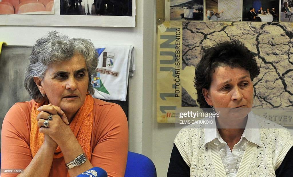Bosnian Muslim women, Zumreta Sehomerovic (L) and Sabaheta Fejzic (R), survivors of the 1995 Srebrenica massacre, watch on April 8, 2015 in Sarajevo a live broadcast from the Yugoslav war crimes court in The Hague, which upheld Bosnian Serb general <a gi-track='captionPersonalityLinkClicked' href=/galleries/search?phrase=Zdravko+Tolimir&family=editorial&specificpeople=4311362 ng-click='$event.stopPropagation()'>Zdravko Tolimir</a>'s life sentence for genocide at the massacre, the worst atrocity on European soil since World War II. AFP PHOTO / ELVIS BARUKCIC