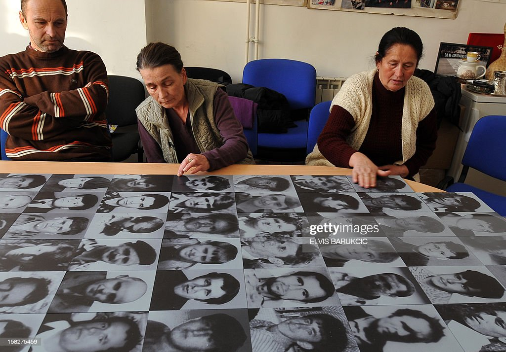 Bosnian Muslims, Sabaheta Fejzic (C), Zijad Smajlovic (L) and Kadira Gabeljic (R), survivors of the 1995 massacre in the Eastern-Bosnian town of Srebrenica, gather in Sarajevo on December 12, 2012 to watch a live television broadcast of the final ruling in the case of former Bosnian Serb general Zdravko Tolimir before the International War Crimes Tribunal for former Yugoslavia (ICTY) in The Hague. The UN's Yugoslav war crimes court found Tolimir guilty of genocide on December 12 for his role in the 1995 Srebrenica massacre, Europe's worst atrocity since World War II, and sentenced him to life in jail.