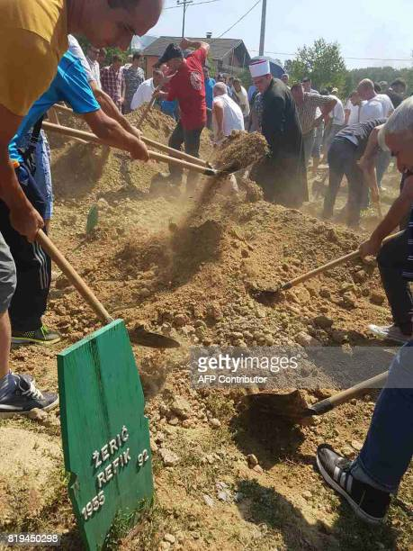 Bosnian Muslims survivors of ethnic cleansing in NorthWestern Bosnia in 1992 use shovels to dig graves during mass burial ceremony in Prijedor Bosnia...