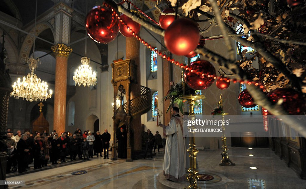 Bosnian Orthodox Serbs attend Christmas Mass at the Congregational Church of' The Mother of God' in Sarajevo, on January 7, 2013. Dominantly Orthodox Christians, Bosnian Serbs observe the old 'Julian' calendar differing from Catholic and secular, 'Gregorian' calendar, established in 16th century.