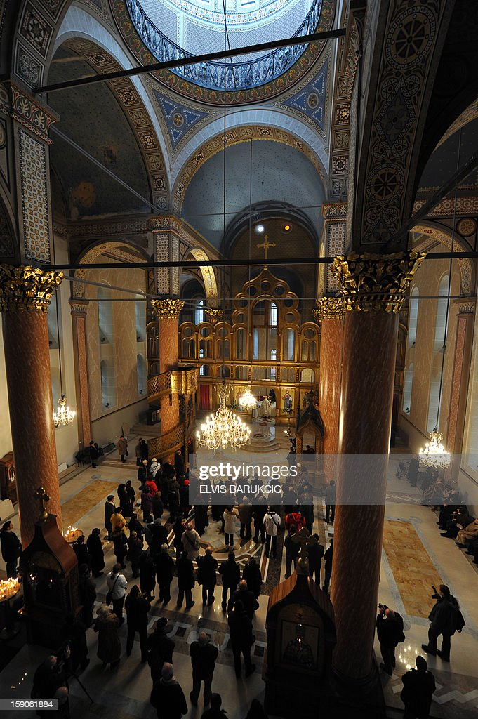 Bosnian Orthodox Serbs attend Christmas Mass at the Congregational Church of 'The Mother of God' in Sarajevo on January 7, 2013. Dominantly Orthodox Christians, Bosnian Serbs observe the old 'Julian' calendar differing from Catholic and secular, 'Gregorian' calendar, established in 16th century.