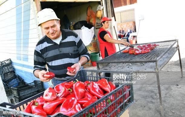 BRIEN Bosnian people bakes red peppers to prepare ajvar on September 24 in Ljetovik near the CentralBosnian town of Kiseljak It's a source of Balkan...