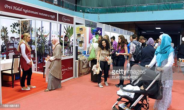 Bosnian people walk among stands during a halal fair gathering 30 producers from the region gathered to present their goods meat products cheese...