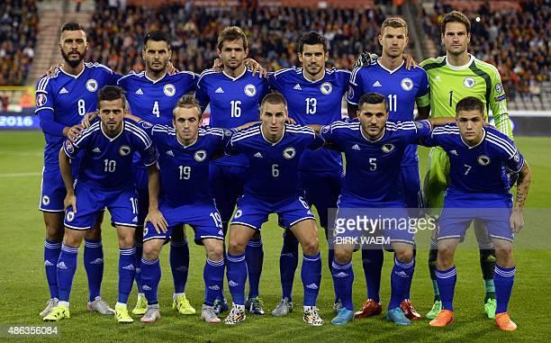 Bosnian players Haris Medunjanin Emir Spahic Senad Lulic Mensur Mujdza captain Edin Dzeko goalkeeper Asmir Begovic and Miralem Pjanic Edin Visca...