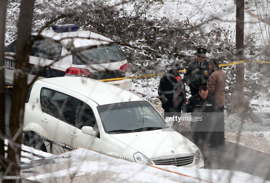 Bosnian police officers investigate at the site of a killing of one of their colleagues, in Sarajevo's northern area of Reljevo, on December 31, 2012. A Muslim policeman was shot dead while guarding a Serbian Orthodox church in a Muslim-dominated village near the Bosnian capital Sarajevo, local religious leaders said Monday, condemning the killing.