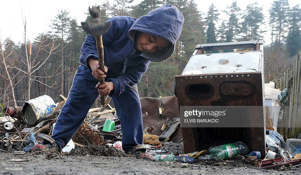 A Bosnian Roma child digs a piece of ground in village of Svatovac, on February 20, 2013. Svatovac, an isolated hamlet with some 200 inhabitants near the northern town of Tuzla, is Nazif Mujic's home. Mujic picked up the Silver Bear for best actor at the Berlin Film Festival for his performance in Bosnian director Danis Tanovic's 'An Episode in the Life of an Iron Picker'. AFP PHOTO/ ELVIS BARUKCIC