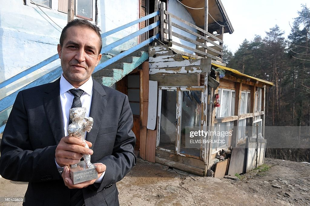 Bosnian Roma, Nazif Mujic (42) holds his Silver Bear prize from 2013 Berlinale, in front of his home in village of Svatovac, on February 20, 2013. Earlier this month, Mujic picked up the Silver Bear for best actor at the Berlin Film Festival. His performance in Bosnian director Danis Tanovic's 'An Episode in the Life of an Iron Picker' was one of the highlights of the festival. AFP PHOTO/ ELVIS BARUKCIC
