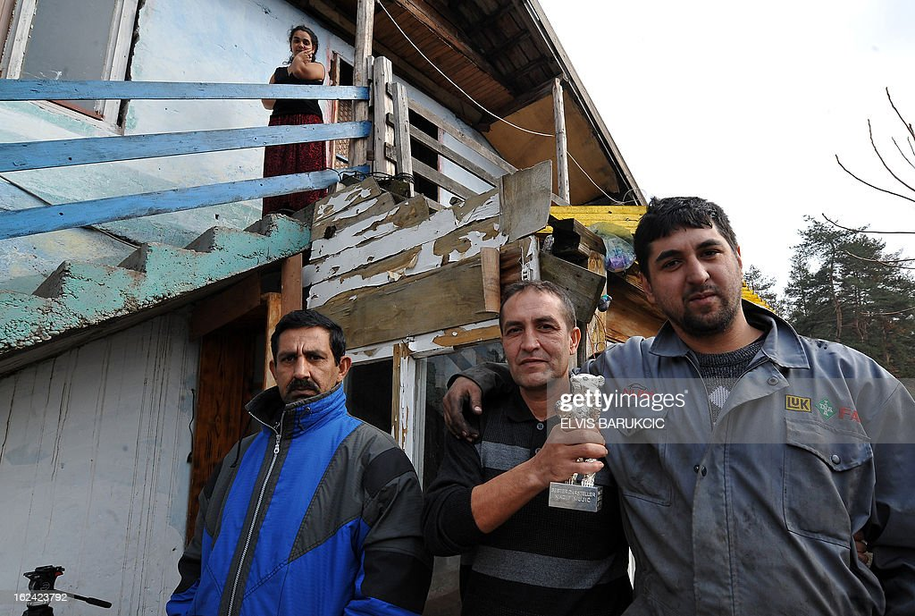 Bosnian Roma, Nazif Mujic (2nd R) poses with his neighbors as he holds his Silver Bear prize from 2013 Berlinale, in front of his home in village of Svatovac, on February 20, 2013. Earlier this month, Mujic picked up the Silver Bear for best actor at the Berlin Film Festival. His performance in Bosnian director Danis Tanovic's 'An Episode in the Life of an Iron Picker' was one of the highlights of the festival.
