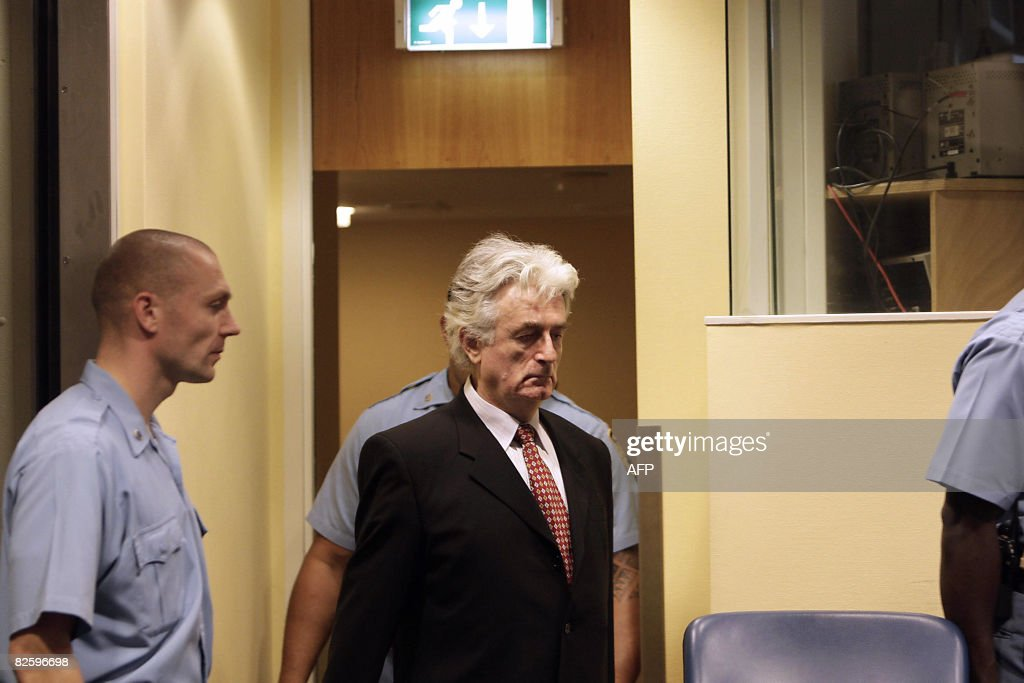 Bosnian Serb wartime leader <a gi-track='captionPersonalityLinkClicked' href=/galleries/search?phrase=Radovan+Karadzic&family=editorial&specificpeople=730778 ng-click='$event.stopPropagation()'>Radovan Karadzic</a> (C) arrives in the UN's Yugoslav warcrimes court in The Hague on August 28, 2008 for his second appearance before the court which is trying him for genocide, war crimes and crimes against humanity. Karadzic, 63, was arrested in Belgrade six weeks ago, 13 years after the International Criminal Tribunal for the former Yugoslavia issued an indictment against him over a campaign of 'ethnic cleansing' during the 1992-95 Bosnian war in which 100,000 people died. AFP PHOTO / ANP PHOTO VALERIE KUYPERS netherlands out - belgium out