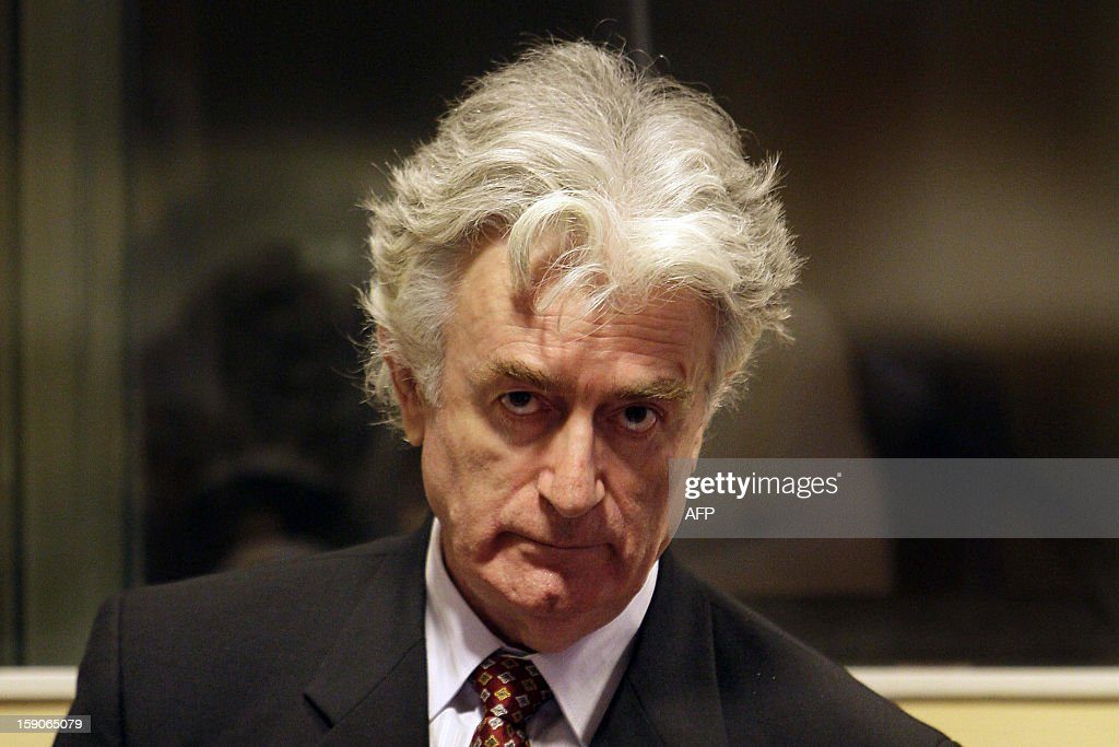 Bosnian Serb wartime leader <a gi-track='captionPersonalityLinkClicked' href=/galleries/search?phrase=Radovan+Karadzic&family=editorial&specificpeople=730778 ng-click='$event.stopPropagation()'>Radovan Karadzic</a> sits in the UN's Yugoslav warcrimes court in The Hague on August 29, 2008 for his second appearance before the court which is trying him for genocide, war crimes and crimes against humanity. Karadzic, 63, was arrested in Belgrade six weeks ago, 13 years after the International Criminal Tribunal for the former Yugoslavia issued an indictment against him over a campaign of 'ethnic cleansing' during the 1992-95 Bosnian war in which 100,000 people died. AFP PHOTO / ANP PHOTO VALERIE KUYPERS netherlands out - belgium out