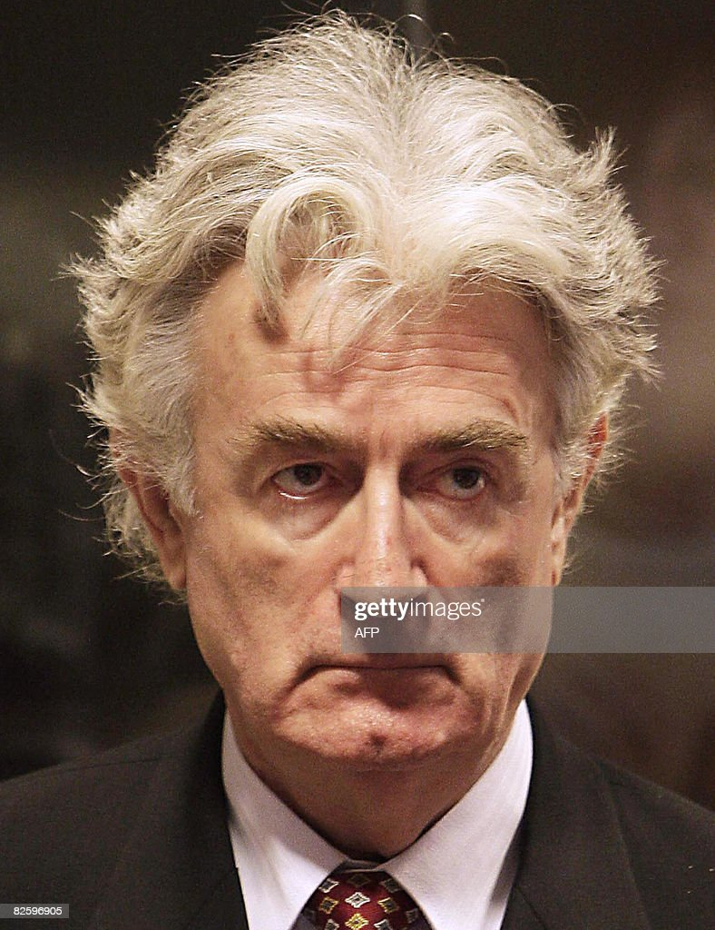 Bosnian Serb wartime leader <a gi-track='captionPersonalityLinkClicked' href=/galleries/search?phrase=Radovan+Karadzic&family=editorial&specificpeople=730778 ng-click='$event.stopPropagation()'>Radovan Karadzic</a> sits in the UN's Yugoslav warcrimes court in The Hague on August 28, 2008 for his second appearance before the court which is trying him for genocide, war crimes and crimes against humanity. Karadzic, 63, was arrested in Belgrade six weeks ago, 13 years after the International Criminal Tribunal for the former Yugoslavia issued an indictment against him over a campaign of 'ethnic cleansing' during the 1992-95 Bosnian war in which 100,000 people died. AFP PHOTO / ANP PHOTO VALERIE KUYPERS netherlands out - belgium out