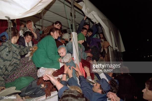 Bosnian soldiers and aid workers help Srebrenica residents to get out late 13 April 1993 in Tuzla The UN convoy which left earlier 13 April the...