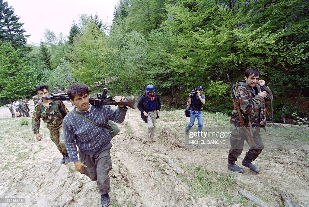 Bosnian soldiers of the first battalion of the First Moslem Brigade of the Podrina's mountain return to their positions at the front line at Kocar on...