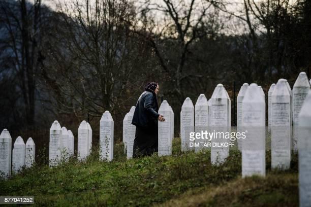 Bosnian woman arrives to offer prayers beside gravestone at the memorial center of Potocari near Srebrenica on November 21 2017 On November 22 ICTY...