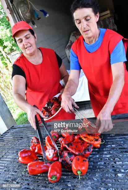 BRIEN A Bosnian woman bakes red peppers to prepare ajvar on September 24 in Ljetovik near the CentralBosnian town of Kiseljak It's a source of Balkan...