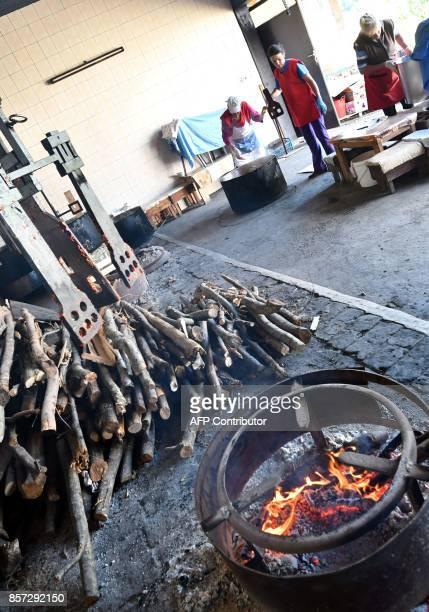 BRIEN Bosnian women bakes red peppers to prepare ajvar on September 24 in Ljetovik near the CentralBosnian town of Kiseljak It's a source of Balkan...