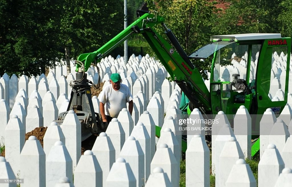 A Bosnian worker, works among graves, as he diggs new tombs in preparation for burial, at the Potocari Memorial cemetery near the Eastern-Bosnian town of Srebrenica, on July 4, 2013. The Potocari Memorial cemetery is undergoing preparations for another mass burial on July 11, when 408 newly identified bodies will be put to final rest. Bodies are identified as those belonging to Bosnian Muslim victims, of the offensive undertaken by Bosnian Serbs in July 1995 with the aim to occupy the earlier declared UN safe heaven area of Srebrenica and the surrounding villages. During the offensive more than 8000 Bosnian non-Serbs went missing to be found buried in mass graves, years after the war ended.