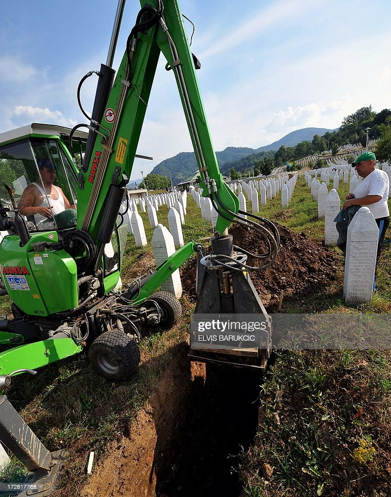Bosnian workers dig new tombs in preparation for burial, at the Potocari Memorial cemetery near the Eastern-Bosnian town of Srebrenica, on July 4, 2013. The Potocari Memorial cemetery is undergoing preparations for another mass burial on July 11, when 408 newly identified bodies will be put to final rest. Bodies are identified as those belonging to Bosnian Muslim victims, of the offensive undertaken by Bosnian Serbs in July 1995 with the aim to occupy the earlier declared UN safe heaven area of Srebrenica and the surrounding villages. During the offensive more than 8000 Bosnian non-Serbs went missing to be found buried in mass graves, years after the war ended.