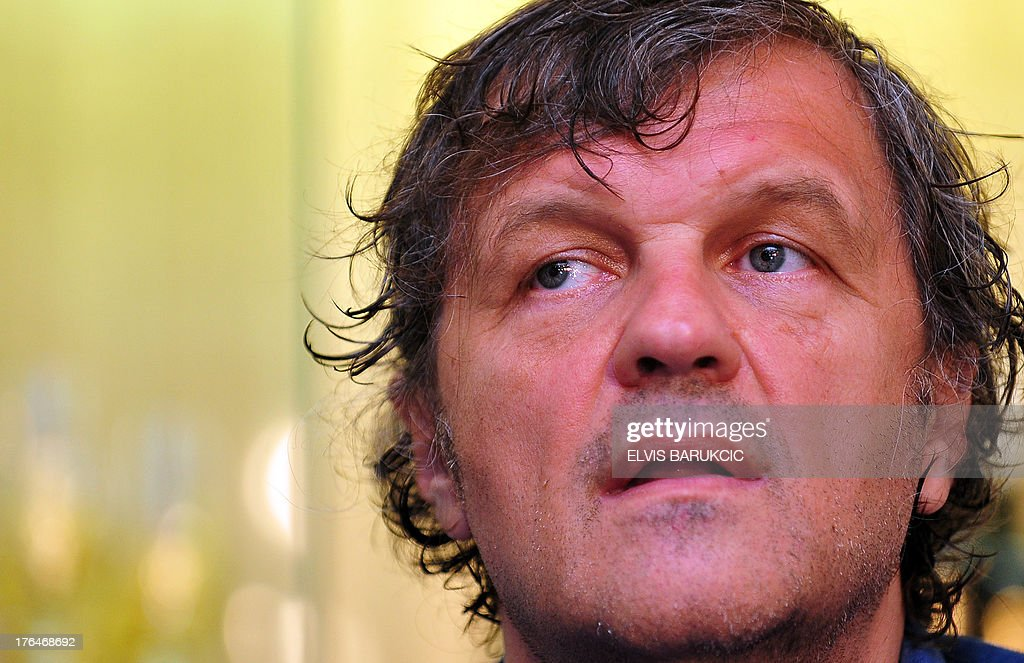 Bosnian-born film director Emir Kusturica answers journalists' questions during a press conference in the southern Bosnian town of Trebinje, on August 13, 2013. Kusturica is currently shooting his newest film, 'On the Milky Road', in southern Bosnia, starring Italian actress Monica Bellucci as a title female role.