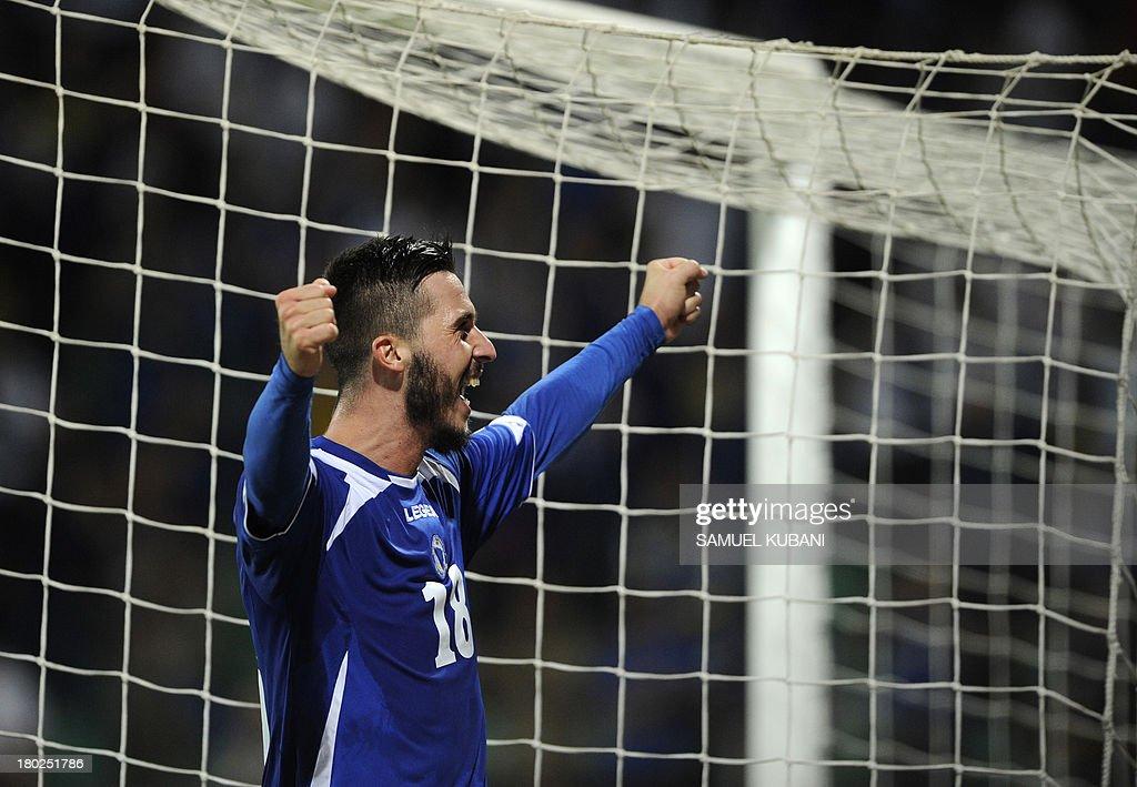 Bosnia's Haris Medunjanin celebrates after the FIFA World Cup 2014 qualifying football match Slovakia vs Bosnia-Herzegovina in Zilna on September 10, 2013. AFP PHOTO / SAMUEL KUBANI