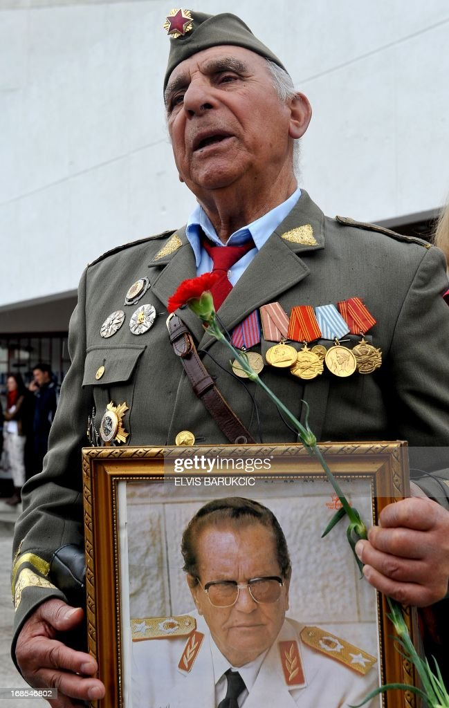 Bosnia's Salko Rizvic, 85, a retired major of ex-Yugoslav People's Army, is seen in uniform holding a photo of late Yugoslav communist leader, Josip Broz Tito, in the Southern-Bosnian town of Jablanica, on May 11, 2013. A crowd of several thousand socialist supporters and sympathisers gathered in Jablanica to commemorate the 70th anniversary of The Battle on the river Neretva, one of the most famous battles of World War II in Yugoslavia. The battle was fought by Tito's Partisans who were vastly outnumbered and outgunned by German forces and their domestic helpers. The Partisans carried a large number of wounded fighters and were followed by several thousands of civillians who were fleeing in front of a German offensive.