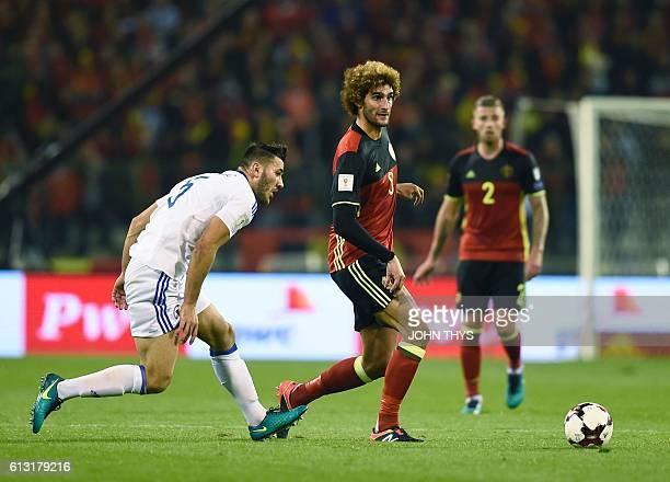 Bosnia's Sead Kolasinac vies with Belgium's Marouane Fellaini during the Fifa WC 2018 football qualification match between Belgium and Bosnia and...